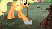 Applejack digging near the library ruins S5E03