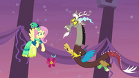 Fluttershy slaps flower out of Discord's paw S5E7