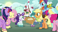 Mane Six gathered around the hat MLPBGE