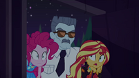 Security guard carrying Pinkie and Sunset EGSBP