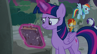 Twilight picks up Star Swirl the Bearded's journal S7E25