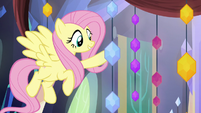 Fluttershy holding a memory jewel S5E3
