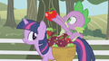 Spike holding up a shiny apple S01E03.png