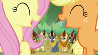 Fluttershy and AJ sharing a laugh S8E23