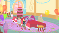 Pinkie Pie laying on the table with derpy eyes S1E25.png