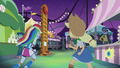 Rainbow and Applejack running to carnival games EG2.png
