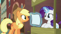 Rarity looking at the flyer S5E16
