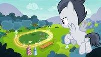 Rumble hovering high over the racetrack S7E21