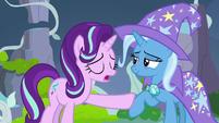 Starlight Glimmer pushing Trixie's hoof away S7E17