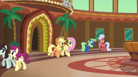 Applejack and Fluttershy leaving the resort S6E20