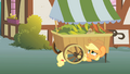 Applejack hiding under a vegetable stand S1E15.png