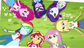 Photograph of Equestria Girls lying in the grass EG4.png