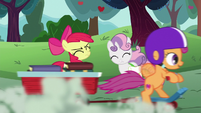 Scootaloo speeds past Apple Bloom and Sweetie Belle S6E14
