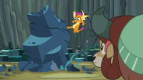 Smolder kicking the giant rock S9E3