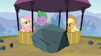 Spike holds a rock S3E09