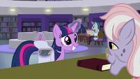 Twilight putting books in her saddlebag S9E5