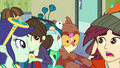 Lyra and Sweetie Drops shove through the crowd EG3.png
