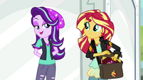 Starlight Glimmer smiling at Sunset Shimmer EGS3