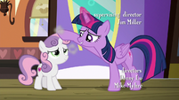 Twilight Sparkle dusting off Sweetie Belle S8E6