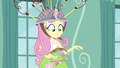 Fluttershy shaking her tambourine reluctantly EG3.png