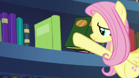 Fluttershy takes more books off the shelf S7E20