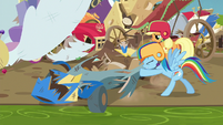 Rainbow Dash pushing her wrecked cart S6E14