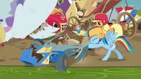 Rainbow Dash pushing her wrecked cart S6E14