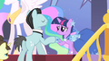 Sir Pony Moore shakes Twilight's hoof S1E26.png