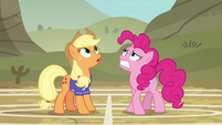 Applejack and Pinkie look up at the softball S6E18