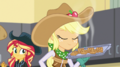 Applejack holding a tray of apple fritters EGS1.png