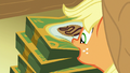 Applejack picks up box of Filly Guide cookies S6E15.png