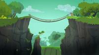 Distance shot of jungle rope bridge S6E13