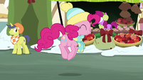 Pinkie Pie bouncing happily through town MLPBGE