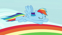 Rainbow Dash flying over a rainbow S7E14