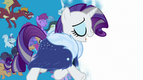 Rarity trotting across a white screen S9E26
