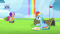 Rainbow sitting down with Scootaloo's scrapbook S7E7