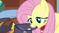 Fluttershy closing up her saddlebag S6E17
