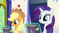 Journal copies float in front of AJ and Rarity S7E14.png