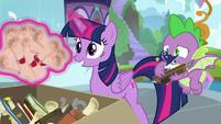 Twilight levitating her old school scrolls S9E5