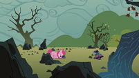 Filly Pinkie pushing a rock S1E23
