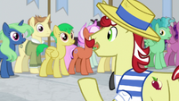 Flam addressing the crowd of ponies S8E16