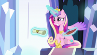 Princess Cadance rolls letter into a scroll S9E1