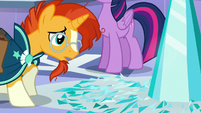 Sunburst looks closely at the shattered Crystal Heart pieces S6E2