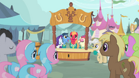 The Ponytones singing in front of a crowd of ponies S4E14