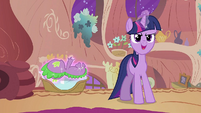 Twilight talking while levitating Spike onto the basket S2E02