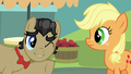 Filthy Rich winking to young Applejack S6E23.png