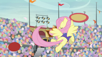 Fluttershy flings the ball to the goal S9E6
