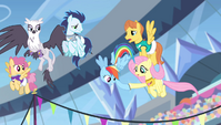 Fluttershy hands horseshoe to Rainbow Dash S4E24