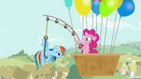 Pinkie Pie pulls Rainbow using a fishing rod S4E12
