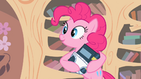 Pinkie Pie rocking a book S2E13